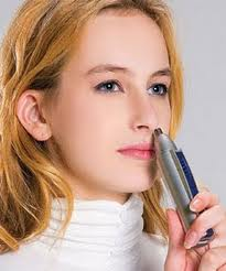 Woman with a nose-hair remover, about to stick it up her nose.