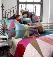 bed piled high with throw pillows